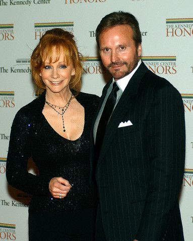 YES! Reba IS married! To her manager actually, Narvel Blackstock, they have been married for 20 years or so and have a 19 year old son Shelby together. Both Reba and Narvel were previously married to other people, Reba was married to Charlie Battles. And Narvel had a few children with his first wife so Reba also has adopted children and I believe she has a few grandchildren