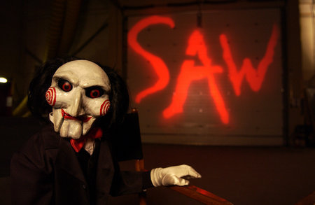 i had a dream about ...have tu seen Saw II? the first scene it was a boy named mike that a mask was connected with him and the key was inside his eye he couldnt bring his eye out so the mask was closed and he died?remember....yeah so i saw him sitting infront of me with that closed mask and talking about how fun it is to be trapped to jigsaw!he is a really nice and funny man.i amor him and these!too nonscence:P