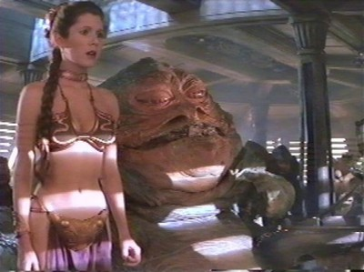 """Its Tatooine, The hottest homeplanet in the galactic system. Jabba is a slave driver, and the head of the Hutts, which means he is a brutal gangster who doesnt give a damn what anybody thinks as long as he gets what he want. toi saw the green lady he """" collected"""". When Leia tried to free Han from the carbon freezing, they got caught. So naturally she had to pay the price, par being put in a slave outfit and tourtured too. I mean tourtured, par being chained up. Besides alot of people in étoile, star Wars a partially naked. Aliens, alien girls, etc."""