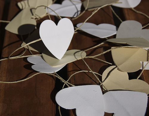 try macking paper hearts that آپ could hang around like this