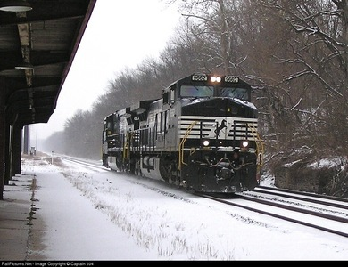 It's not the best photo, but this is a picture of a train going oleh a train station that's not too far from my house. :) I live in Pennsylvania.