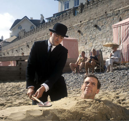 My favourite TV (and book) character: Bertie Wooster. He's the one in the sand, par the way. :)