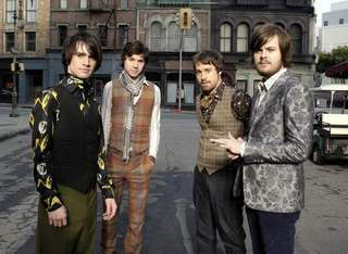 Panic at the Disco. theyre not my all time favorito but the lead singer's got a hot smile!