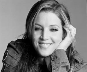 Lisa Marie Presley. Her música is, bull's eye, my taste in music. And her voice is, right on the bat, my favorite.