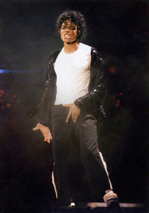 OMGSH YEAH!!! I think the whole outfit is sexy! I love how the shirt & jacket fits on him and his pants too.... and the hat just tops it off! I have a poster (not the pic below) in my room from one of his Billie Jean performances and I just daydream when i look @ it its a sexy pose & the way MJs face is in it I just drool over it sometimes :] <3