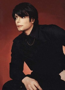 Hi I had a good look around the web for you...I know there is a photoshoot that Michael did for Dolce and Gabbana with his hair like this but I couldn't find anything on it....I have this one though hope toi like it :)