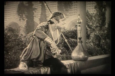 I am not completely sure but I think it was [i]The Thief of Bagdad[/i] starring Douglas Fairbanks.