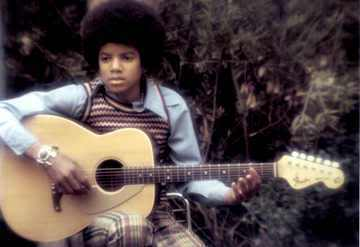 He played the guitar, the kinanda and the drums.. but he didn't play any instrument on stage (maybe because he had to dance).. he loved to play the kinanda (and he was very, very good..) in their childhood Michael and his brothers used to steal their father's guitar... and learn how to play..:)