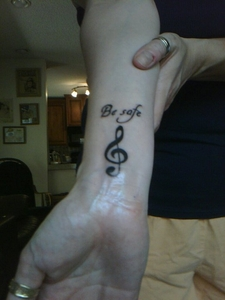 This is Mine...It is Subtle..The Clef note because Edward likes Music..