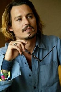 Johnny Depp indead remains for me one of the most talented actors and he can really be a role model. he is 47 married and has 2 children no divorces no scandals no nothing maybe you haven't noticed but lately many holywood couples divorce but not Johnny he is not involved in scandals or things like this he is a wonderful actor and man who stays at his place .