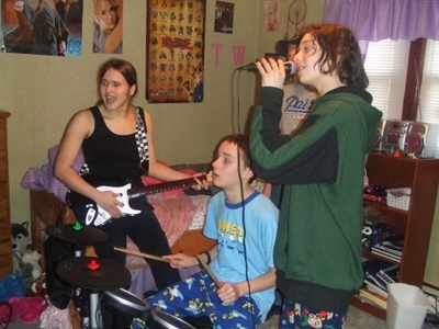 Me and my little brothers playing rock band. yes i have stuffed जानवर but i have no shame in दिखा रहा है them off.