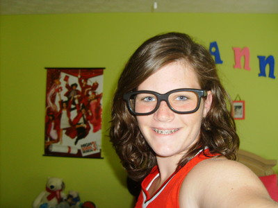 heres me im do u think im pretty please be honest u wont hurt my feelins usually my hair is straight but i rag curled it i try not to hav my hair the same way in the same week plus i dont hav a single spec of makeup on and i look horrible and dont ask bou the glasses i was bored before softball practice