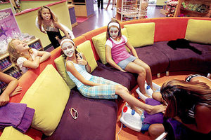 Best Friends Rachel Beard, 12, left, and Claire Benninghoff, 10, get pedicures from salon manager Susane Lozano, far right, while sisters Shannon Cureton, 7, far left, and Sara Cureton, 10, giggle and watch at Sweet & Sassy, a salon that caters to childre