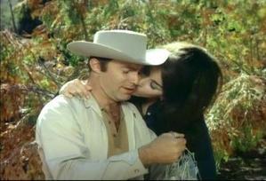 Garth as Tom Palmer with his onscreen wife Erica Gavin as the título character Vixen!