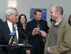 "In 2002, Mayor Tom Murphy presented the key to the city to Pittsburgh native David Hollander, executive producer and creator of ""The Guardian."" In background are Wendy Moniz and Simon Baker."