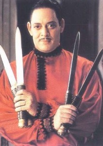 R-Raul Julia played Gomez Addams in 1991 and 1993
