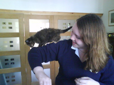 me in my old school uni  (RIP)  with my mates kitten  :D 