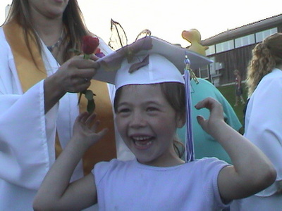 Me at my older sister's high school graduation and she let me wear her pet, glb thing - this was 7 years a