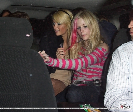 here's ur pic of avril in a car! well that was pretty easy! and i have many pics of her in car! but o