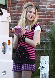 here she is holding a box full of chocolates. now, i want a pic where avril is using a green t-shirt,