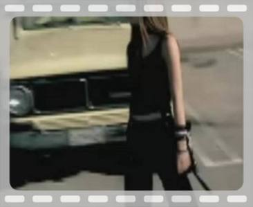 I want a picture of Avril playing (or holding) a football.