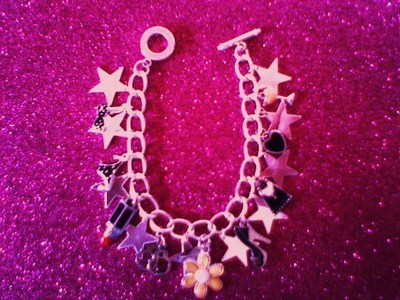 Sex and The City Chick Flick Charm Bracelet available at http://www.dollheartcandy.com Sorry pic d