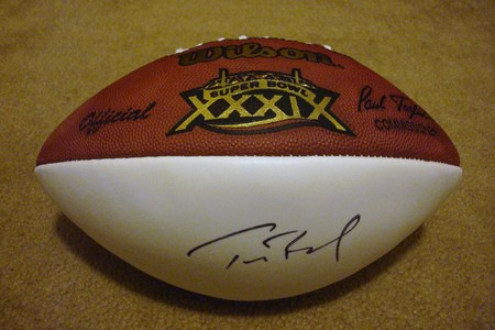 The SUPERBOWL XXXIX football, autographed by Tom Brady, is up for raffle at $5 per ticket (max. of 10