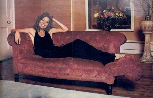 Diana Rigg on sofa