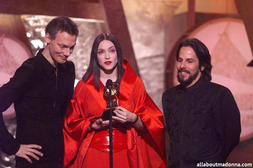 Madonna accepting an award with William Orbit at the Grammy Awards (February 24 1999)