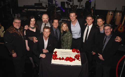Jensen with the cast and the crew at the 100th episode party