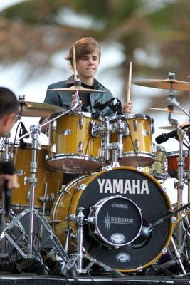 Justin Bieber playing drums