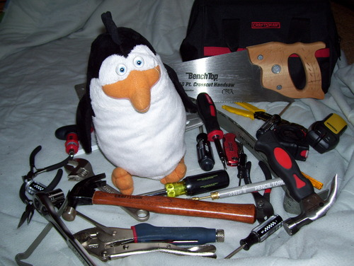 Penguins of Madagascar wallpaper called Rico and His Tools