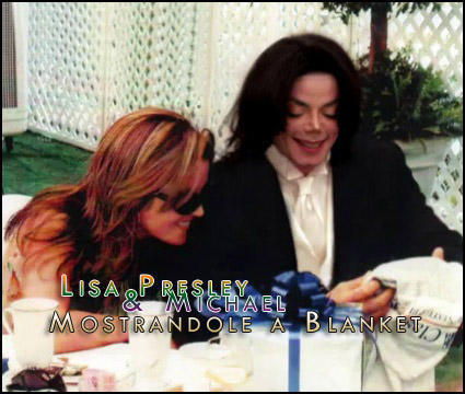 Michael Jackson presenting blanket to lisa marie