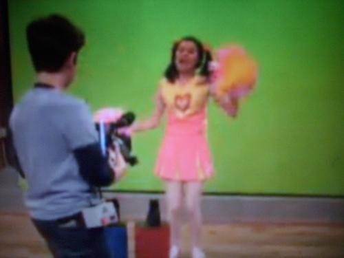 Carly as Melanie Higgles