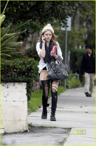 Dakota Fanning Dons Shredded Tights