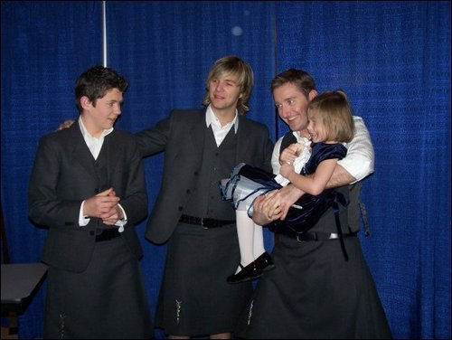 Paul, Damian, and Keith with a little girl