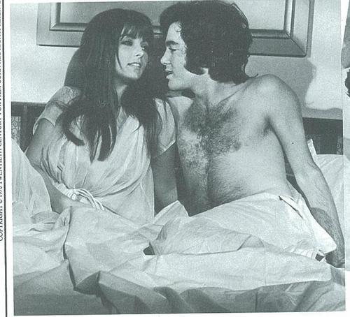 David Gurian as Harris in cama with Dolly as Kelly