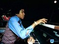 Michael and the piano  - michael-jackson photo