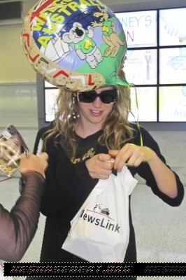 Ke$ha arriving is sydney and maxim photoshoot