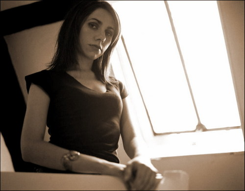 PJ Harvey in Sepia with Light Shining in the Window