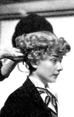 Audrey trying on a blond wig for Roman Holiday