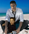 Michael Scofield with his little son MJ on the beach