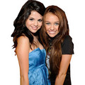 shinee - miley-cyrus-vs-selena-gomez photo