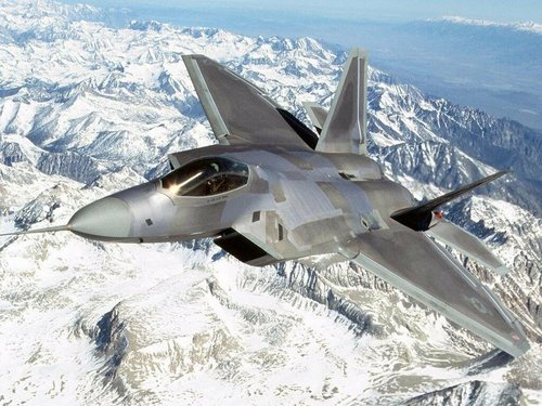 F-22 over mountains