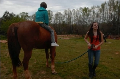 Justin, Caitlin, and her horse