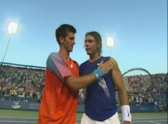 djoko and rafa embrace