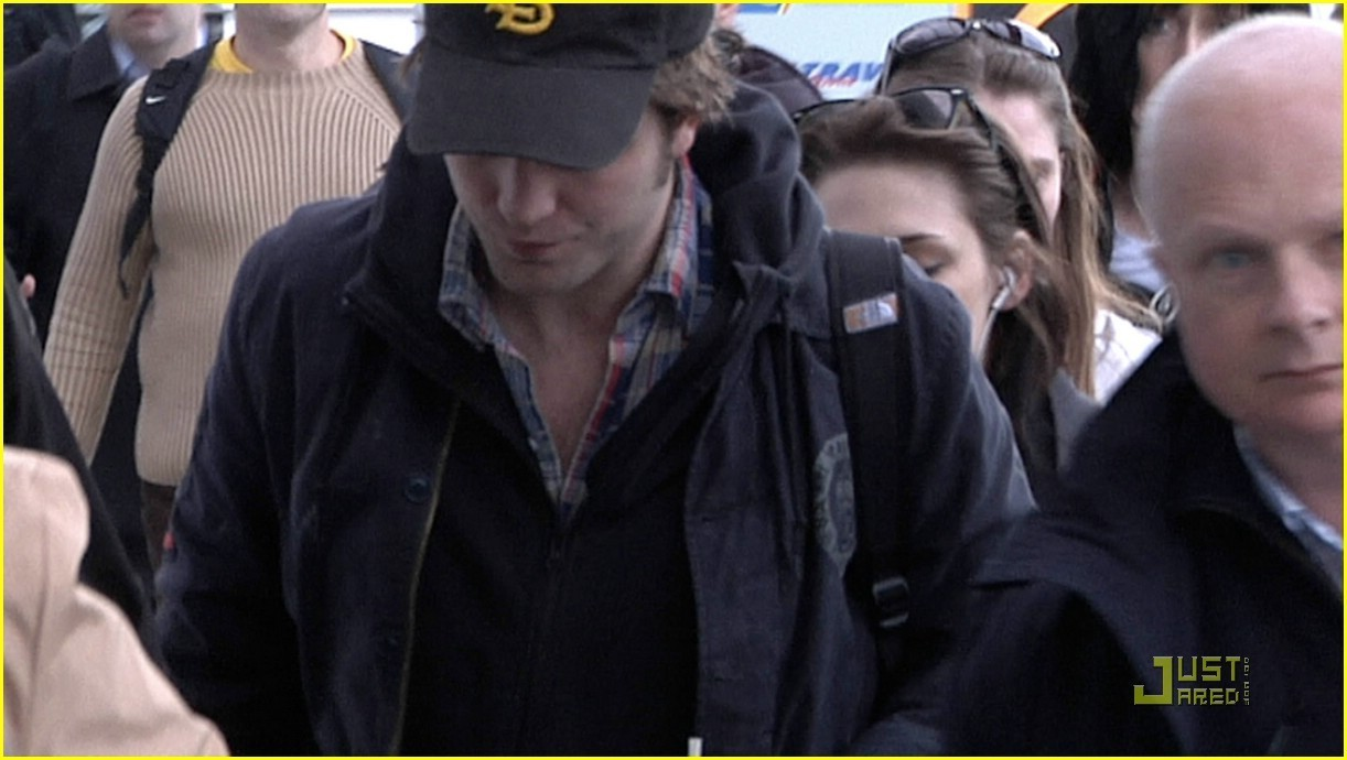 rob and kristen at the airport in budapest