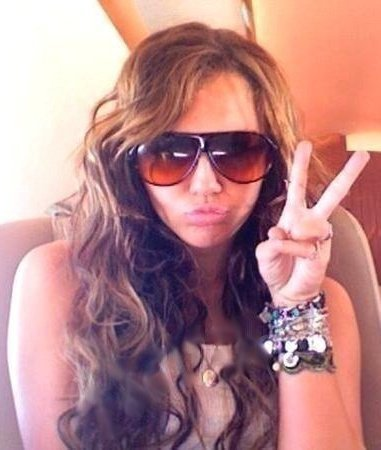 http://images2.fanpop.com/image/photos/11500000/PEACE-miley-cyrus-11548482-381-450.jpg