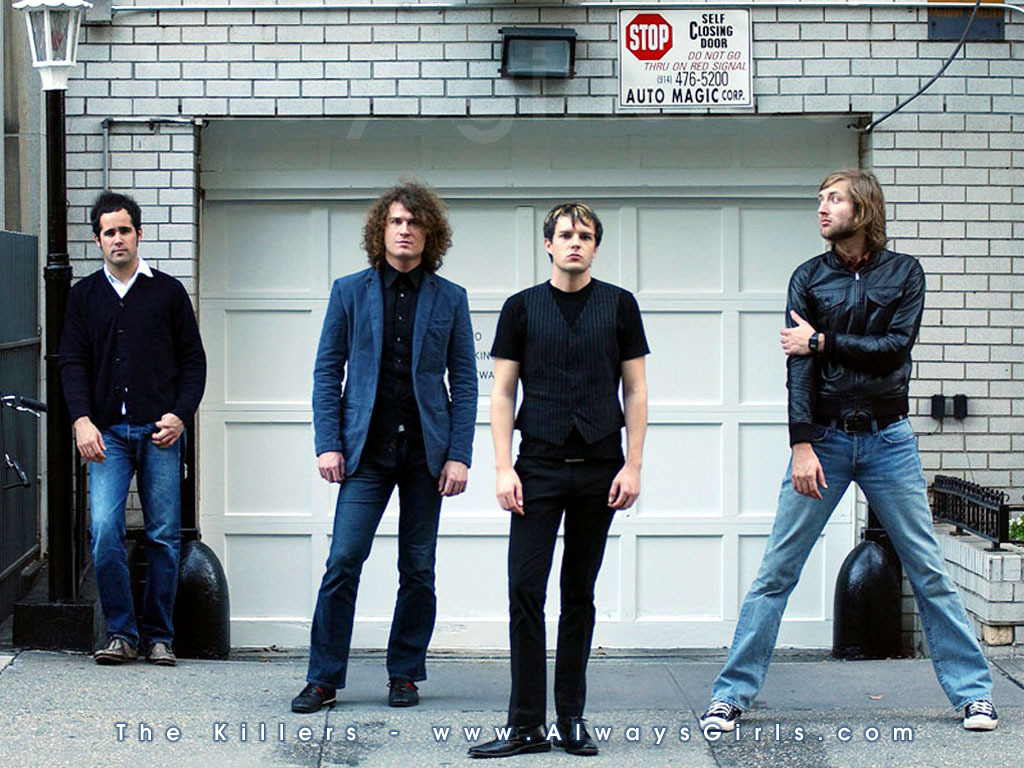 The Killers Standing In Front Of A Garage The