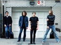 The Killers... Standing in front of a garage. - the-killers wallpaper